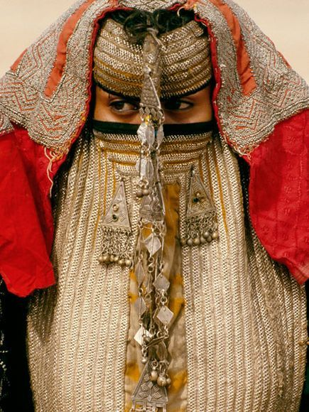 Rashaida Bride, Eritrea Photograph by Carol Beckwith and Angela Fisher Veiled behind an elaborate mask called a burga, a Rashaida bride stays in seclusion before her wedding. The Muslim Rashaida are Bedouin merchants and camel breeders, originally from Saudi Arabia, who keep to themselves and marry only their own.