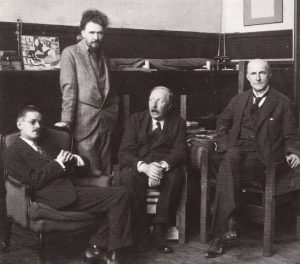 James-Joyce-Ezra-Pound-Ford-Maddox-Ford-and-John-Quinn-in-Pounds-Paris-studio-1921-696x612